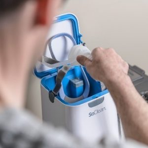 CPAP machine being inserted in SoClean