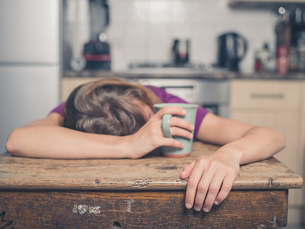 picture of tired woman with a mug